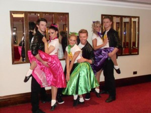 rock and roll dancers posing at an event