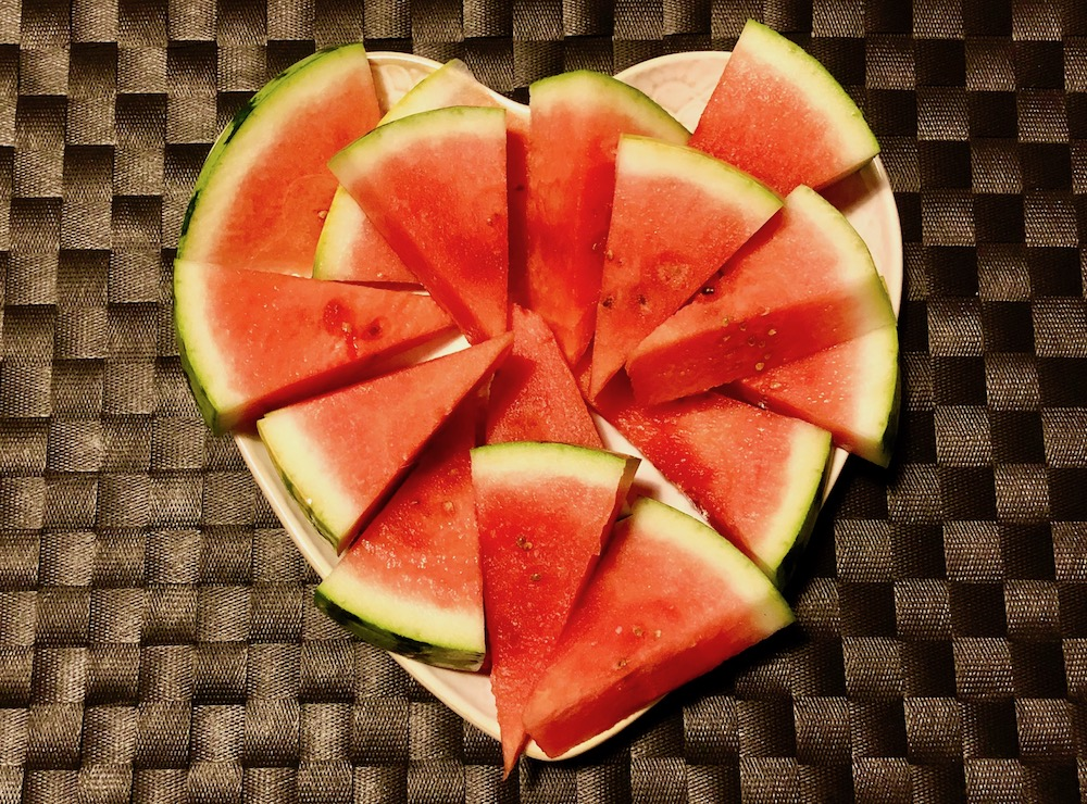 Watermelon pieces in the shape of a heart.